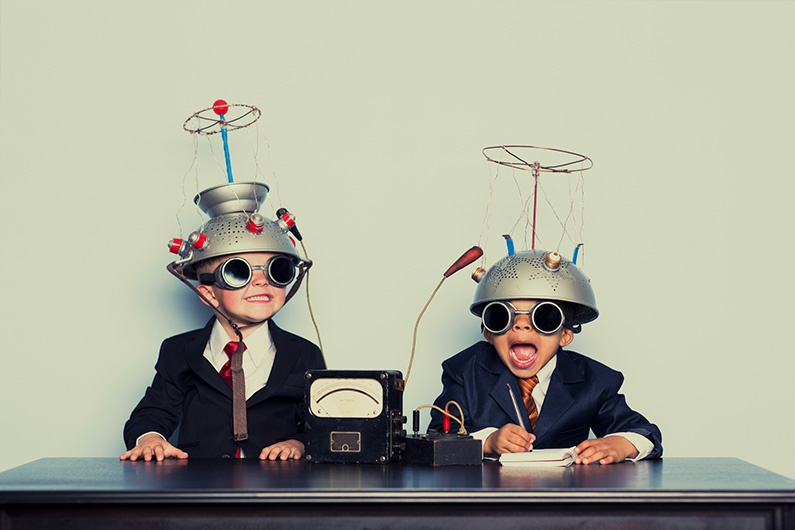 Two young boys perform an experiment with B2B emails